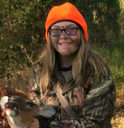 After years of wanting and hunting and never givinmg up, her first deer!!