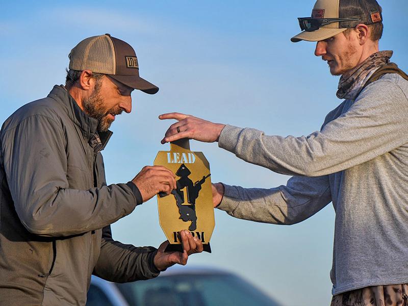 Caylen Wojcik photo accepting an award