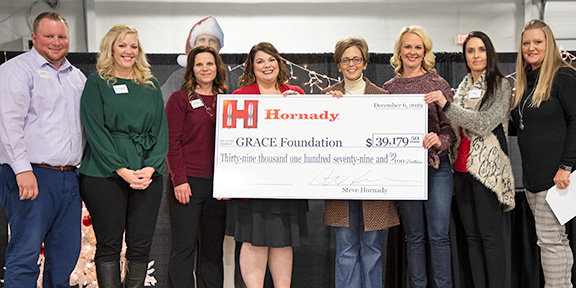 Photo of Grace Foundation receiving donation